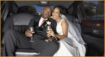 Happy Bridal Couple in Limo